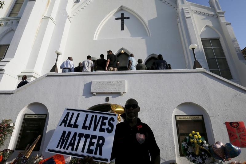 Church-goers wait to enter the Emanuel African Methodist Episcopal Church in Charleston, South Carolina June 21, 2015, for the first service in the church since a mass shooting left nine people dead during a bible study. REUTERS/Brian Snyder